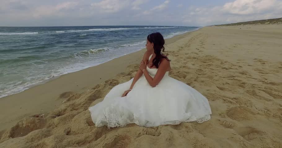 Woman sitting on the beach   Shutterstock HD Video #20448379
