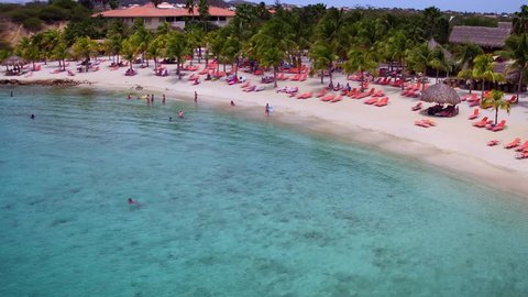 4K aerial fly away at Blue Bay beach and resort, Curacao