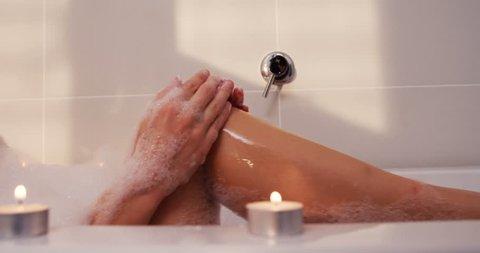 Woman taking bath in bathtub at bathroom 4k