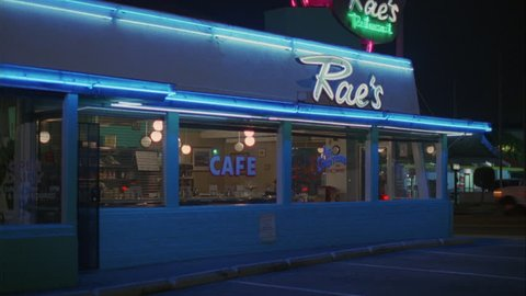 night Tight approx. 5 seconds classic 50s style Raes diner cafe Tilt up right neon signs