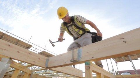 Carpenter building timber frame house.