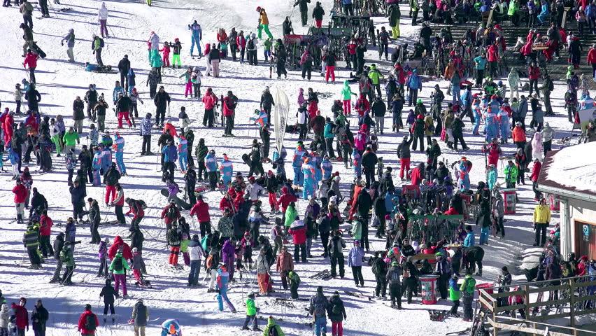 Crowd of people skiers in Bansko World cup ski resort, 4k