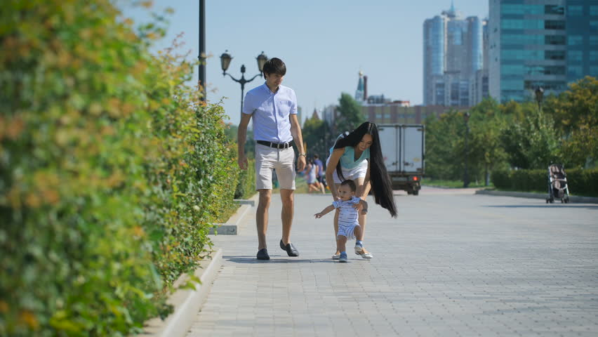 Young family walking along the alley. #20547799
