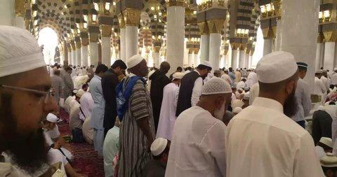 AL MADINAH, SAUDI ARABIA, Muslims praying and reading Quran inside Masjid (mosque) Nabawi on March 9, 2016 in Al Madinah, S. Arabia. Nabawi mosque is the 2nd holiest mosque in Islam.