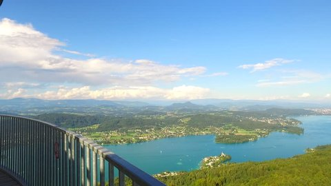 Observing Austria, Klagenfurt lake Worthersee, Klagenfurt city and other Austrian villages near, mountains far away. From Pyramidenkogel, biggest wooden tower in the world with its 100 m (328 ft).