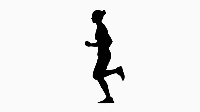 Woman jogging. Side view. Silhouette. Slow motion