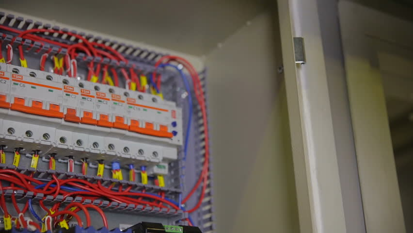 1 electrician installing equipment, turning switch on in a fuse box switches at nearapp.co