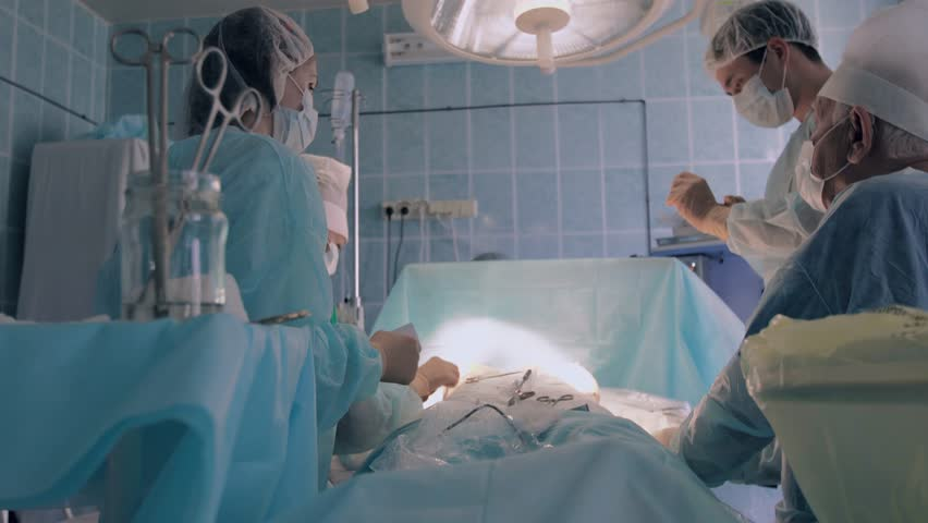 Surgeon turning the light under correct angle to continue surgery | Shutterstock HD Video #20615059