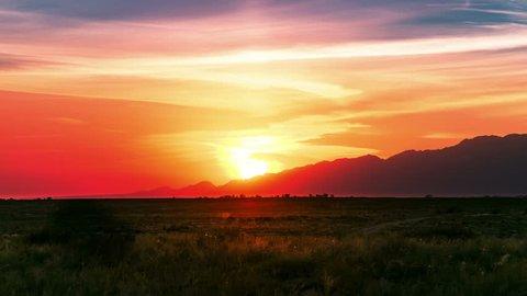Steppe with dry plants at sunset sky in Altyn Emel national park, Kazakhstan, Central Asia. 4K TimeLapse - September 2016, Almaty and Astana, Kazakhstan