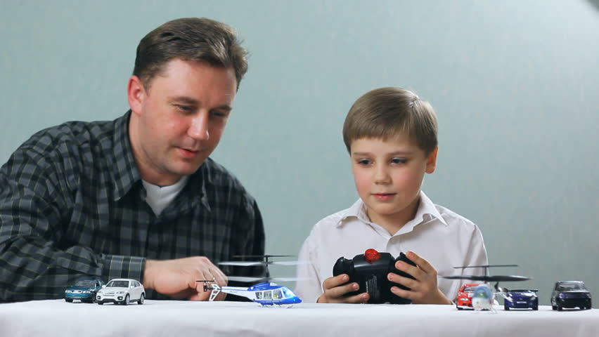 Boy Toys For Dads : Stock video clip of father and boy playing with a toy