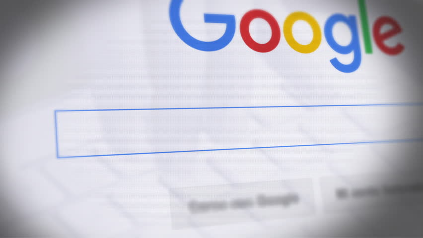 Google Search Engine - Search For Antibiotics Monitor with reflection hands typing a search on google