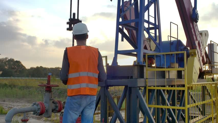 Engineer Inspects Oil Rig | Shutterstock HD Video #20749420
