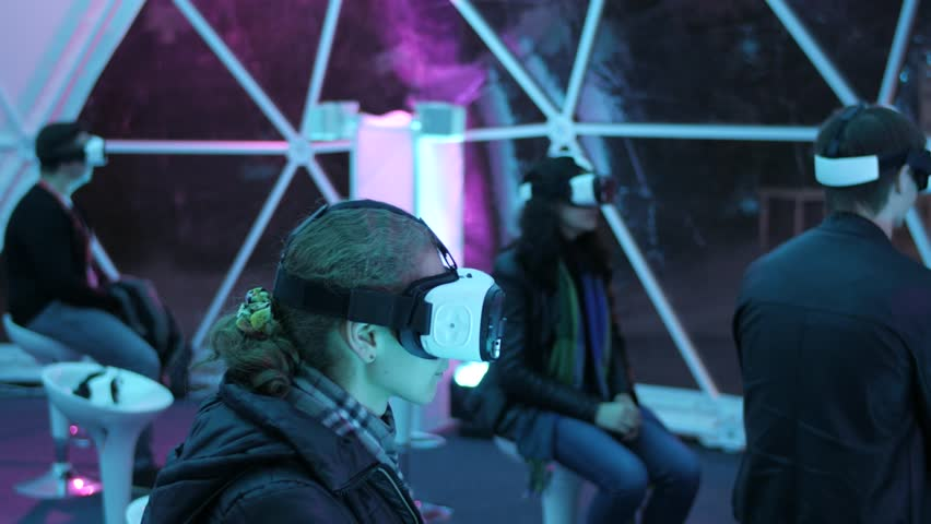 Woman watching movie in vr goggles. VR cinema , innovation, entertainment concept