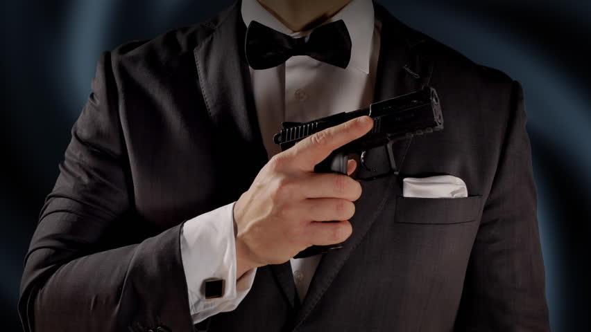 4K Man Holding Gun on Chest, Black Tuxedo and Bow Tie, Secret Agent Spy