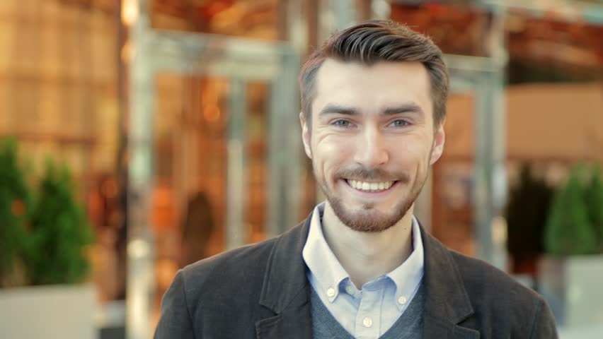 Portrait of handsome happy smiling man with a beard laughing | Shutterstock HD Video #20821459