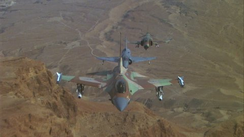 day Air to Air F 16 Falcon fighter jet, followed MiG 23 F 21 Kfir F 4E Phantom II, over desert terrain warfare, dogfight playback