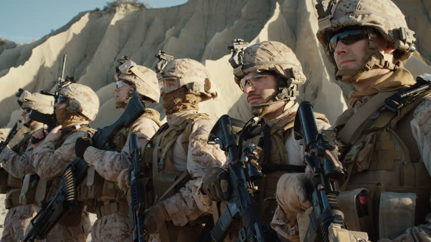 Group of Fully Equipped Soldiers Standing in a Line in the Desert. Shot on RED EPIC Cinema Camera in 4K (UHD).