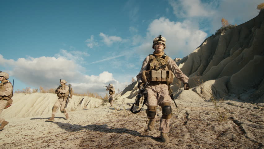 Squad of Fully Equipped, Armed Soldiers Running and Attacking During Military Operation in the Desert. Slow Motion. Shot on RED EPIC Cinema Camera in 4K (UHD).