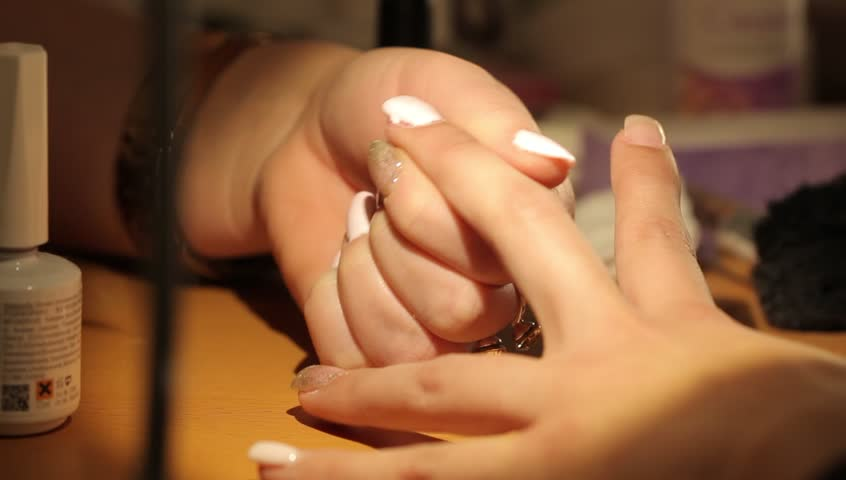 Master makes the girl manicure hands at salon | Shutterstock HD Video #20895079