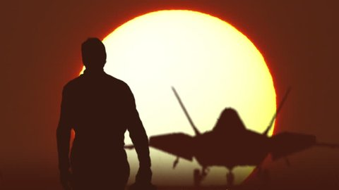 F22 fighter pilot walks against sunrise