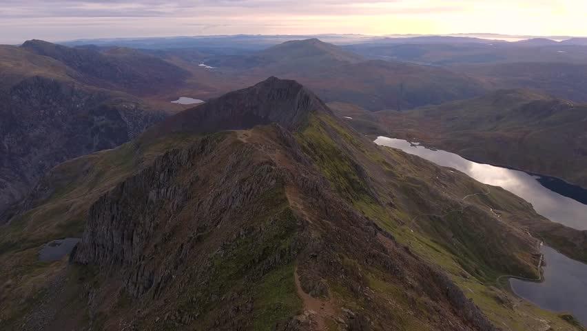 Long aerial view flying over Crib Goch in Snowdonia.