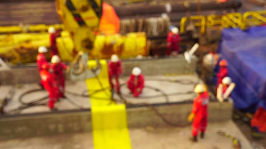Offshore workers with motion blur view doing heavy lifting preparation on the deck. | Shutterstock HD Video #20923579