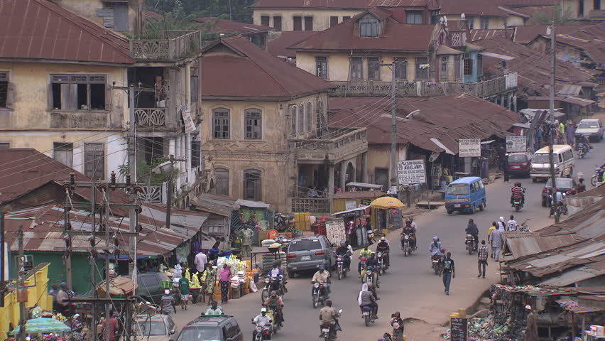 Osogbo, Nigeria - August 2013; High angle view of traffic and business on main street.