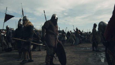 Walking Crowd of Medieval Warriors during Rest Between Battles. Medieval Reenactment. Shot on RED Cinema Camera in 4K (UHD).