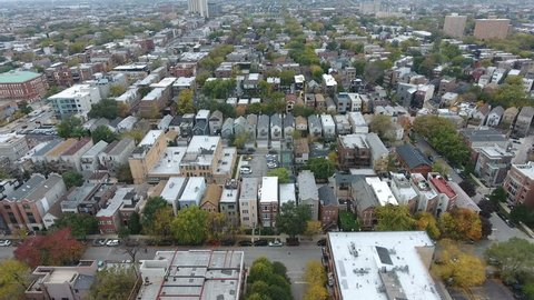 Wicker Park Streets, Aerial of densely populated city neighborhood, camera fly over at a fast pace showing massive city