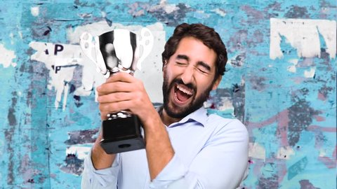 young funny man winning a cup on grunge wall