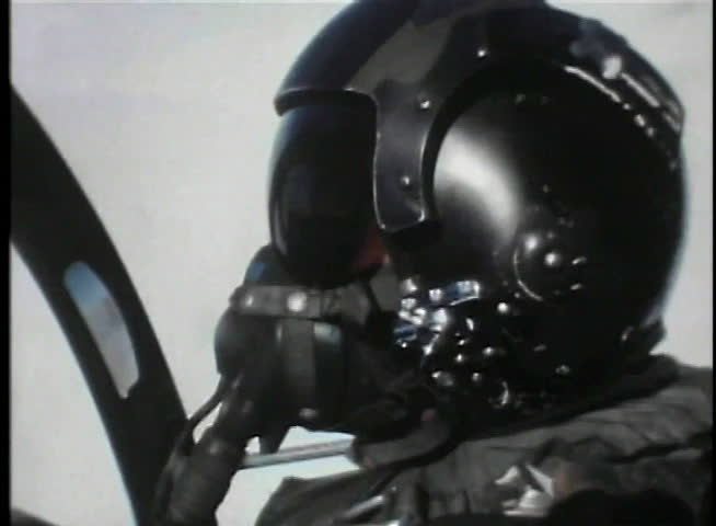 Close-up of pilot sitting in cockpit of fighter jet