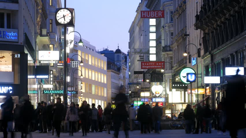 VIENNA - FEB 21: (Timelapse View) Tourists walk on Kartner Strasse across evening Vienna, on Feb 21, 2012 in Vienna, Austria