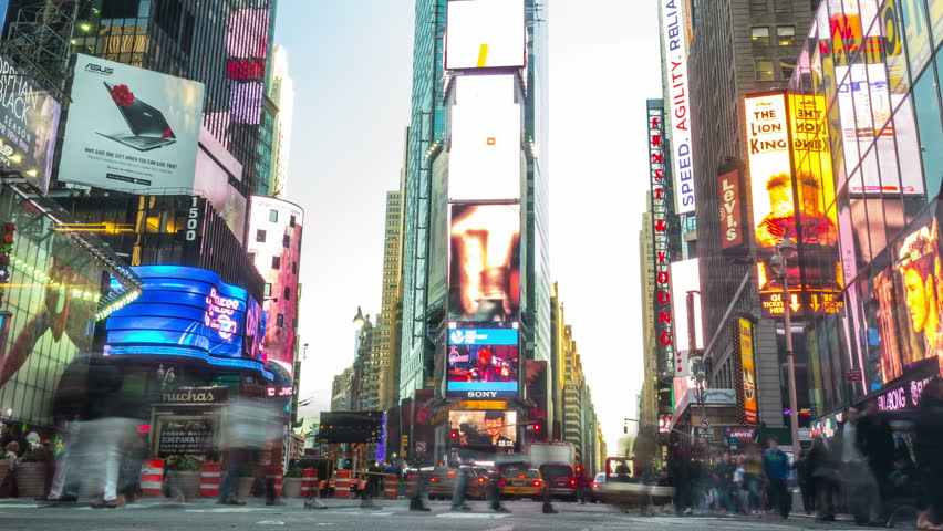 NEW YORK CITY - April 14, 2014: Times Square. Zoom out, from day to night. Crowded street and traffic at the most famous commercial intersection and neighborhood in Midtown Manhattan. United States.  | Shutterstock HD Video #20991376