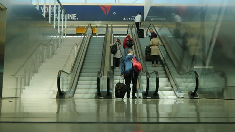 New York, USA - OKTOBER 12, 2016: Passengers use the escalator at the JFK airport in New York City