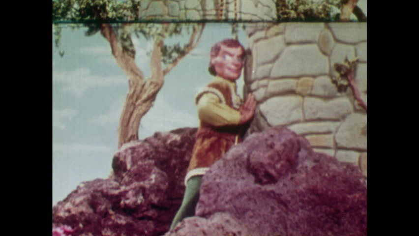 ANIMATED 1950s: Man hides behind tower as witch leaves and Rapunzel pulls up her hair. Boy calls up to Rapunzel.