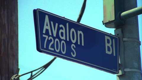 day CU Avalon Bl 7200 s street sign South Central, Los Angeles