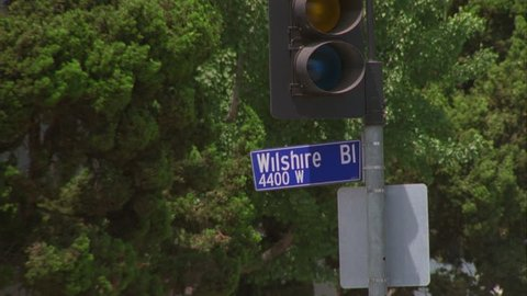 day CU Wilshire BL 4400 W street sign, Los Angeles