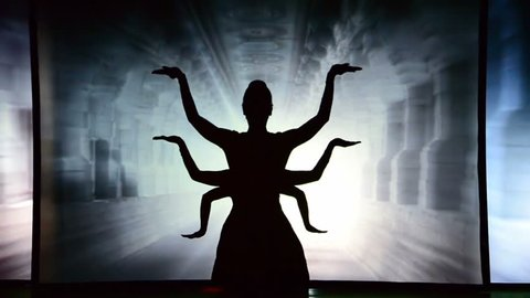 BERDYANSK, UKRAINE - OCTOBER 30: Selfie against the background of tourist sights. Performance by the theater of shadows in front of a backlit white screen in Berdyansk, Ukraine on October 30, 2016