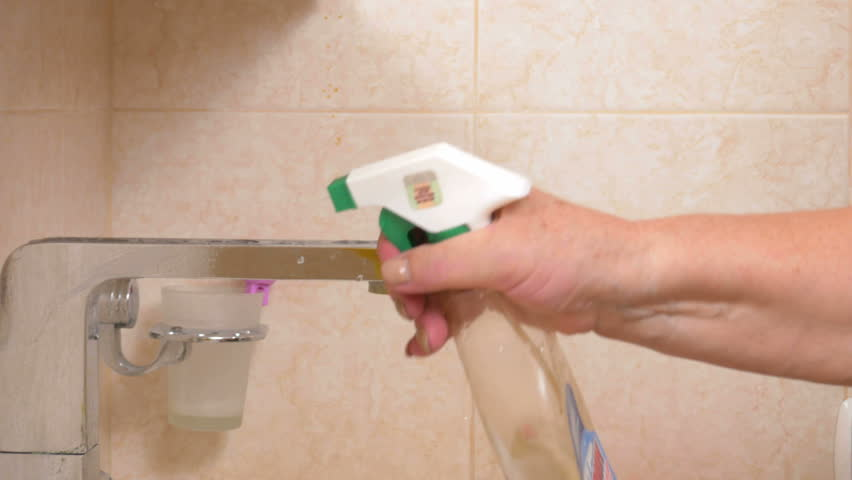 Bathroom Joint Compound carpenter smooths coat of joint compound over taped seam stock