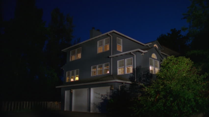 Magic Hour Wide Raked left large two story house hill, blue wood white trim, attached 2 car garage