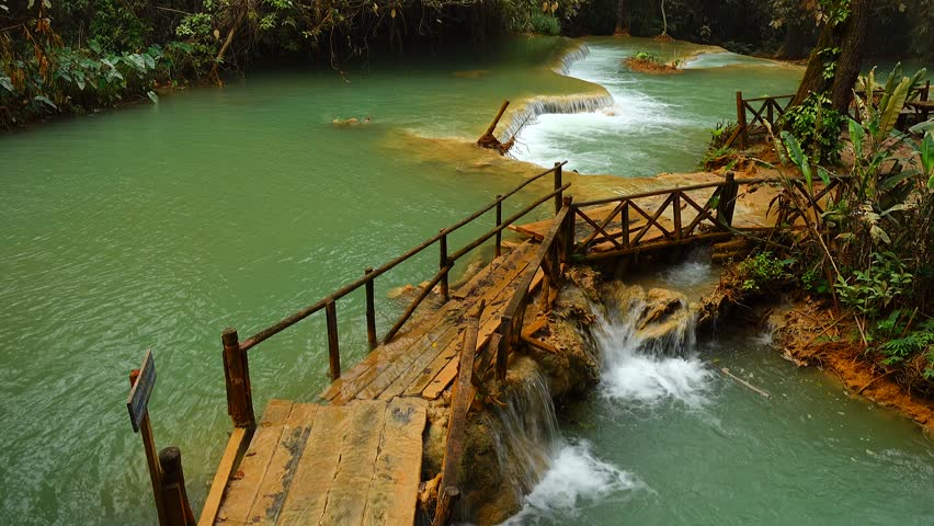 4K Cascade of Kuang Si waterfall or Kuang Xi or Tat Kuang Si Falls, South of Luang Prabang, Laos.