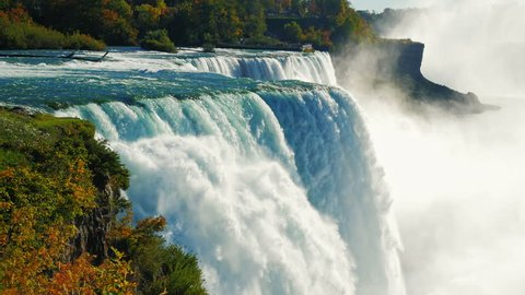 The famous waterfall Niagara Falls, a popular spot among tourists from all over the world. The view from the American side. Slow motion ProRes HQ 422 10 bit video