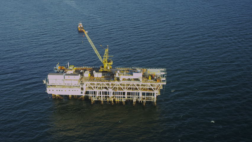 Aerial view of deep ocean oil rig production platform, USA | Shutterstock HD Video #2126369