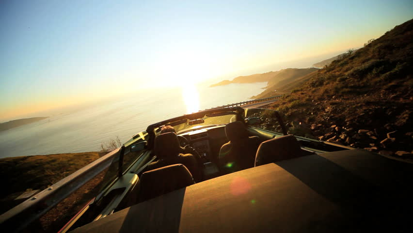 Dream vacation road trip in a red Cabriolet convertible | Shutterstock HD Video #2127047