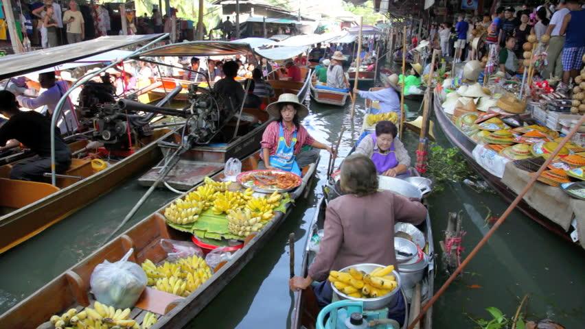 DAMNOEN SADUAK, THAILAND - FEBRUARY 25, 2012: Two women are selling food in