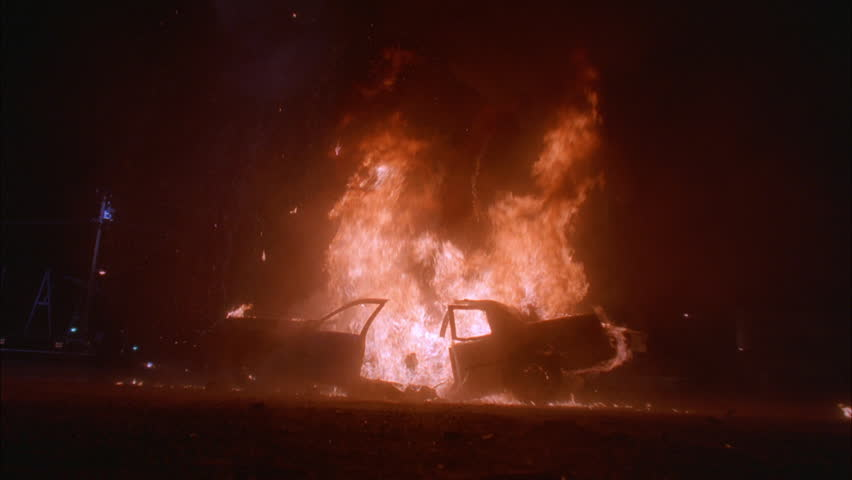 Night Burning car sedan, explodes huge fireball 2nd explosion destroys car Black limo slowly through background murder, news footage, playback, mafia | Shutterstock HD Video #21322699