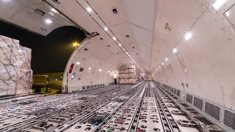 Loading air cargo freighter inside aircraft