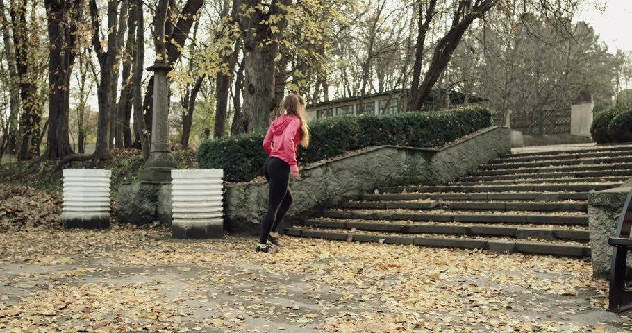 Fitness girl running up stairs in slow motion. Young woman fitness workout. Weight loss exercise. 4k Red Epic.