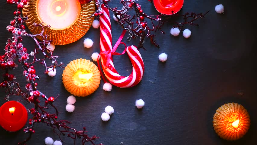 hd0026christmas holiday food background with candy cane decorations candles garland and evergreens border over dark background table new year - Candy Cane Christmas Table Decorations