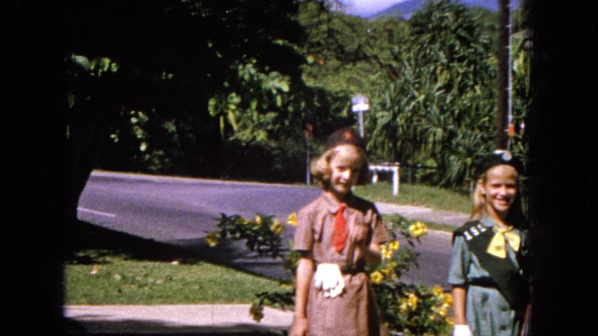 HAWAII 1965: three young girls outdoor dress in brownie or girl scout uniforms